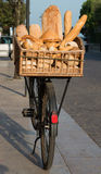 Bicycle with basket of bread Stock Photos