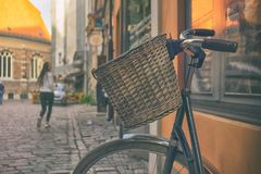 Bicycle with a basket in the center of the old town Stock Photography