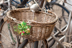 Bicycle basket with flowers. Bicycle basket made of straw, with flowers Royalty Free Stock Images