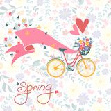 Bicycle with a basket full of flowers. Stock Photography