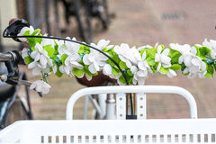 Bicycle basket. A lacerated with flowers Holland bicycle Royalty Free Stock Photography