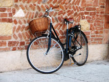 Bicycle with a basket. At the old brick wall stock photo