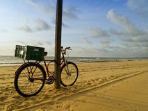Classic bike in Recife beach, Brazil Stock Photography