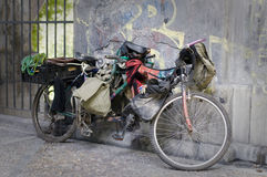The bicycle of a Beggar. Stock Images