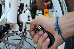 Bicycle is being repaired - close-up stock photos