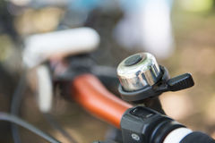 Bicycle bell on handle bar. Ring Royalty Free Stock Photo
