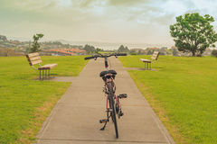 Bicycle, bench and view on sea. Whangaparaoa, Auckland, New Zealand, horizontal photo, photo took in New Zealand, photo is usable on picture post card Royalty Free Stock Photo
