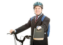 Bicycle Bible Salesman. Bicycle salesman or missionary handing you a copy of the bible. Isolated on white royalty free stock photography