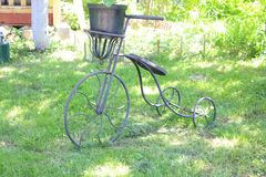 Bicycle he 7 44 Bicycle. I saw somewhere in Russia. Garden decoration in the form of a child is great royalty free stock photos