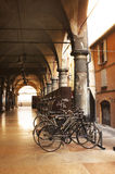 Bicycle and bicycle and porches. Bicycles parked in the old arcades Royalty Free Stock Images