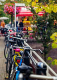 Bicycle. With big magenta bell at the autumn street. Selective focus Royalty Free Stock Images