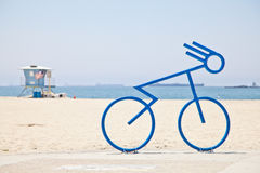 Bicycle bike rack at the beach. Bicycle bike rack made to look like a person riding a bicycle. Located along the coastline and city of Long Beach, California Royalty Free Stock Photo