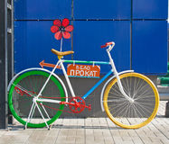 Bicycle with Bike Rental sign and flower. Colorful bicycle with Bike Rental sign and flower Stock Image