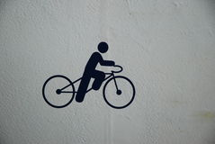 Bicycle and Bike Rider Icon Sign Stock Photos