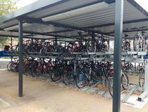 Bicycle or bike shed. Bicycles in multi storey bike shed at derby railway station, england royalty free stock photos