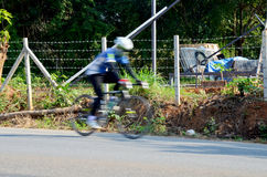 Bicycle blurred because speed of people biking bicycle Stock Images