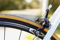 Bicycle brake. Road bicycle brake caliper and pads stock images