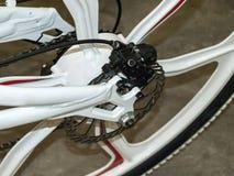 Bicycle brake system. Mountain bicycle rear wheel with mechanical disc brake stock photo