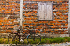 Bicycle and Brick Wall Stock Photo