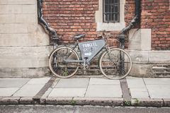 Bicycle on brick wall Stock Images