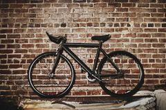 Bicycle and brick wall background Stock Image