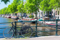 Bicycle on the bridge in Amsterdam Royalty Free Stock Photos