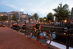 Bicycle on the bridge in Amsterdam Netherlands Stock Photos