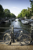 Bicycle on a bridge on a canal in Amsterdam, Netherlands Royalty Free Stock Photos