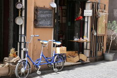 A bicycle built for 2. Blue bicycle in Florence, Italy Royalty Free Stock Images