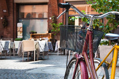 Bicycle and Cafe. Traditional bicycles parked outside a cafe restaurant in Bologna, Italy Royalty Free Stock Photography