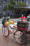 A bicycle carrying boxes of Christmas gifts in Devonport, Auckland, New Zealand. A bicycle carrying boxes of Christmas gifts in Devonport, Auckland. Devonport is Stock Photo