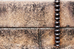 Bicycle chain on brick Royalty Free Stock Photos