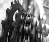 Bicycle chain detail. Black and white picture of a close-up on rear bicycle gears and chain Royalty Free Stock Image