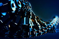 Bicycle chain in a DNA form. 3d macro illustration of a bicycle chain in the form of DNA with depth of field blur effects Royalty Free Stock Images
