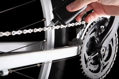 Bicycle chain oiling. Studio shot on black backgorund Royalty Free Stock Photography