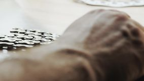 Bicycle chain piled on the table stock footage