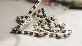 Bicycle chain piled on the table stock video