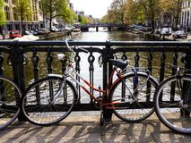 Bicycle on a canal in Amsterdam stock photos