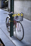 Bicycle chained to pole Royalty Free Stock Photos