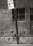 Bicycle chained to pole Stock Images