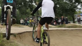 Bicycle challenge looser, rider comes second finishing last. Stock footage stock footage