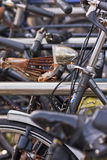 Bicycle chaos. Close-up of parked bicycles with rusty parts Royalty Free Stock Images