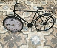 Bicycle with clock, old decorative interior decoration royalty free stock photography