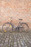 Bicycle on Cobble Stone against Brick Wall; Groot Begijnhof; Leu Stock Images
