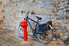 Bicycle on cobblestone street in the old town. Bicycle on cobblestone street in the old town in France royalty free stock photography