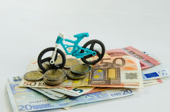 Bicycle, coins and banknotes Stock Photography