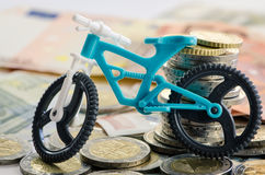 Bicycle, coins and banknotes Stock Image