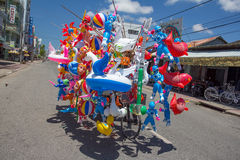 bicycle with colorful balloons on the street. Royalty Free Stock Images
