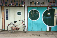 Bicycle and colourful doors, Pai, Stock Image