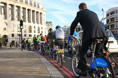Bicycle commuters in London. London, UK - October 2, 2010 - Bicycle commuters on their way to work after crossing Blackfriars bridge in early morning Royalty Free Stock Images